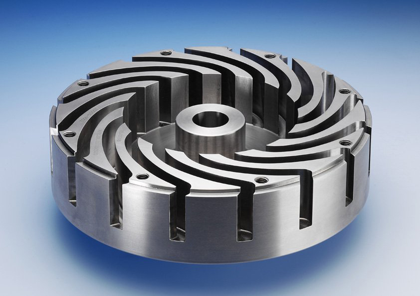 Rotary atomizer wheel with curved vanes