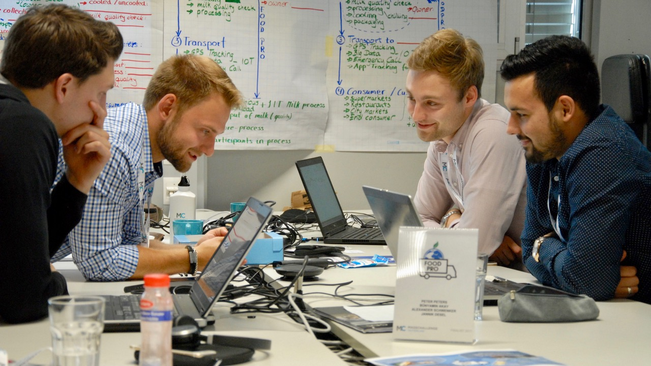The entrepreneurs spent a lot of time in the MassChallenge offices in Lausanne, working on the MilkBuddy. From left to right Alexander Schwenker, Peter Peters, Jannik Desel and Bünyamin Akay (GEA)